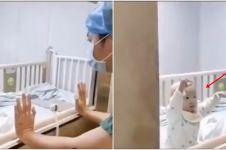 Detik-detik pilu bayi terisolasi virus Corona minta peluk ayah