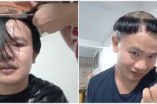 Aksi pria cukur rambut model payung, jadi hiburan warganet