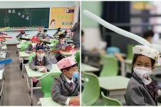 Sekolah kembali buka, murid di China pakai topi physical distancing