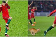 10 Editan foto Cristiano Ronaldo dikejar kucing ini nyeleneh abis
