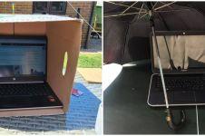 10 Aksi lindungi laptop dari sinar matahari ini kocak abis