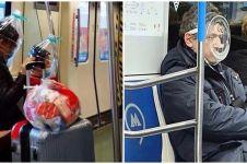 20 Potret penumpang kereta kenakan masker absurd, nyeleneh banget