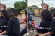Viral aksi pria karaoke di tengah jalan, bikin gagal paham