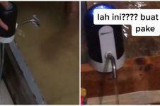 Viral aksi warga kuras genangan banjir dengan pompa galon, bikin kagum