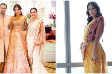 Gaya 11 seleb kondangan kenakan baju India ini bak artis Bollywood