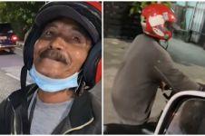 Habis bensin bapak ini rela dorong motor, alasannya bikin sedih