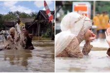 Momen tak biasa pengantin foto saat banjir, gaun pernikahan disorot