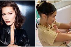 9 Potret Bella Hadid momong keponakan, anak Gigi Hadid dan Zayn Malik