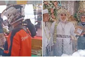 Viral pengantin terima paket di pelaminan, jadi foto terbaik di kurir