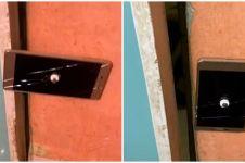 Viral HP dijadikan kunci pintu kamar mandi, ini fakta di baliknya